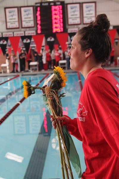Senior, Jenna Ballinger, is honored at the senior home swim meet on Saturday, January 31st against Davidson.