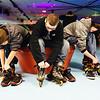 JOED VIERA/STAFF PHOTOGRAPHER- Lockport, NY-Christian Elson, Ramond Elson and Dakota Klock put on their rollerblades before skating at Skateland. Friday, January, 16, 2015