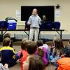 JOED VIERA/STAFF PHOTOGRAPHER Lockport, NY-Robin Sanecki shows kids Olivia a blind screech owl at the Lockport Public Library. Tuesday December 30, 2014