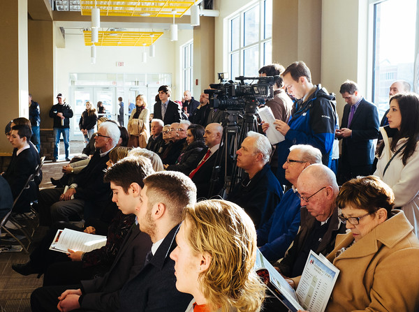 JOED VIERA/STAFF PHOTOGRAPHER- Lockport, NY-The crowd and media watch the press conference at Cornerstone Arena before the start of the first hockey tournament held in Lockport in close to 30 years. Friday, January, 16, 2015