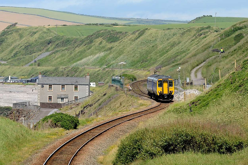 10 July 2015 :: Pictured passing Nethertown Station is 156463 and the train is 2C44, the 1054 from Carlisle to Barrow-in-Furness