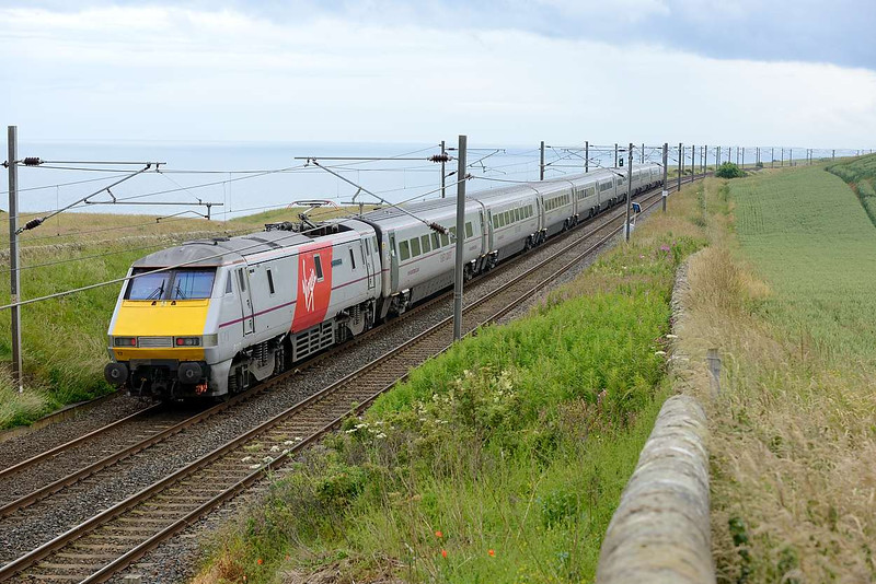 13 July 2015 :: 91117 is pictured along the coastal line at Lamberton working 1E14, the 1200 Edinburgh to Kings Cross
