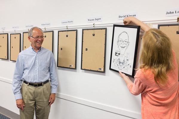 JOED VIERA/STAFF PHOTOGRAPHER-Lockport, NY-David Kinyon watches as his caricature is revealed at the Niagara History Center.