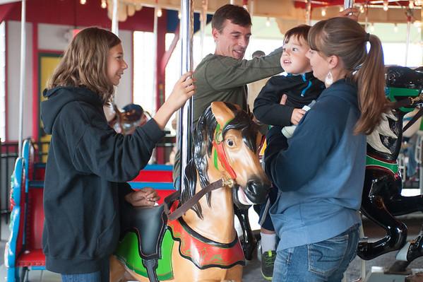 JOED VIERA/STAFF PHOTOGRAPHER-Olcott, NY- Emma Stanczyk, Jeremy Broecker, Jacob Stanczyk 1, and <br /> Jeanne Stanczyk take a ride on the Carousel at Olcott Carousel Park.