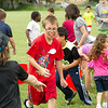 JOED VIERA/STAFF PHOTOGRAPHER-Lockport, NY-Kids play in a water balloon fight at Altro Park.