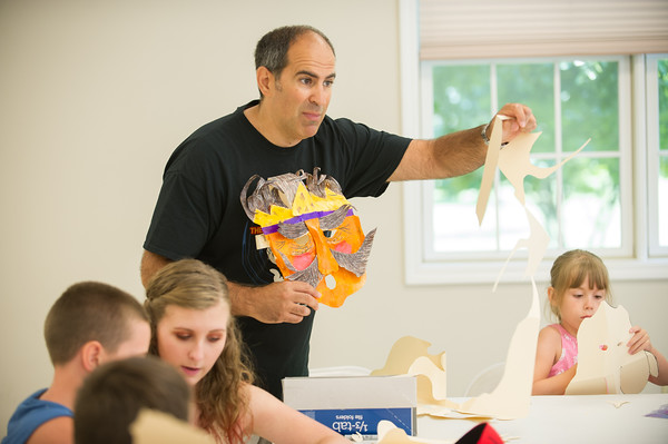 JOED VIERA/STAFF PHOTOGRAPHER-Lockport, NY-Pete D'Angelo helps participants make masks during the Theatre Enrichment Program at the Kenan Campus.