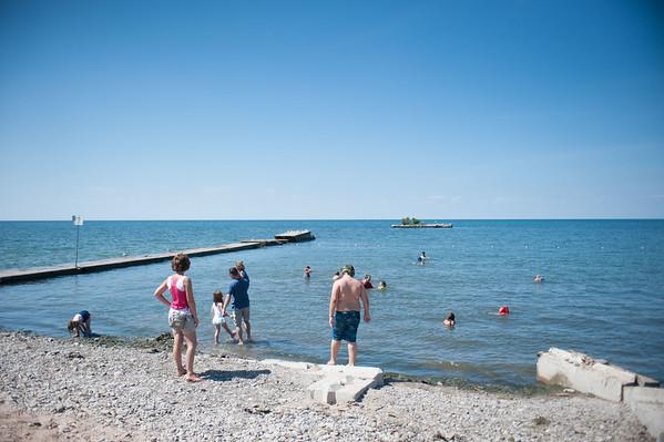 JOED VIERA/STAFF PHOTOGRAPHER Olcott, NY- Patrons take a dip into Lake Ontario at Olcott Beach.