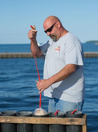 JOED VIERA/STAFF PHOTOGRAPHER-Olcott, NY-  Mark Mongeon sets up the Olcott Beach Fireworks behind the Yacht Club.