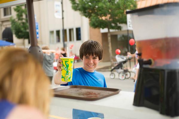 JOED VIERA/STAFF PHOTOGRAPHER-Lockport,NY-Joseph Kavanaugh 13 picks up some lemonade at the Taste of Lockport.