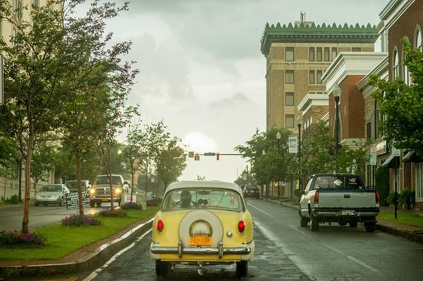 JOED VIERA/STAFF PHOTOGRAPHER-Lockport, NY-Elaine Rhodes drives a 1959 Metropolitan down Main Street.