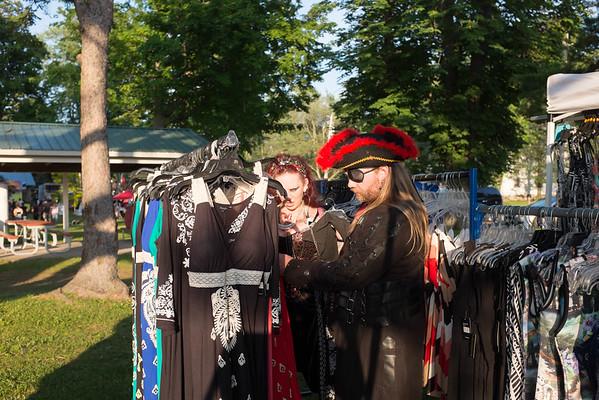 JOED VIERA/STAFF PHOTOGRAPHER-Olcott, NY-<br /> Clayton Kelley/Captain Snake Pliskin and Tessa Barrett/Siren <br /> shop around during Piratesfest.