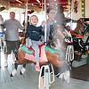 JOED VIERA/STAFF PHOTOGRAPHER-Olcott, NY- Harper Pollock 3 rides on the Carousel at Olcott Carousel Park.