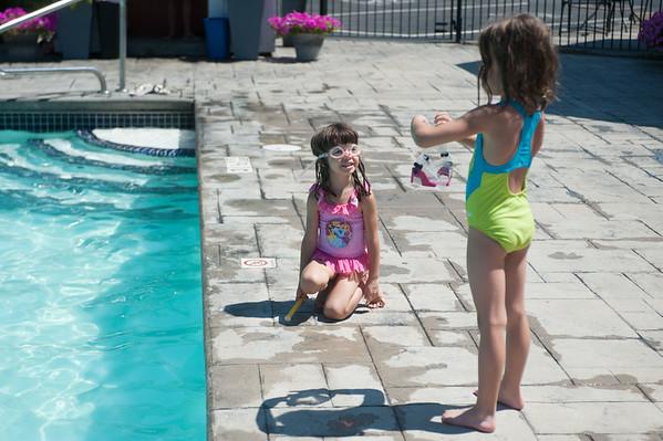 JOED VIERA/STAFF PHOTOGRAPHER Wilson, NY-Emily Bolos 3 and Elena Bolos 6 get ready to take a dip in Linnea's Pool.