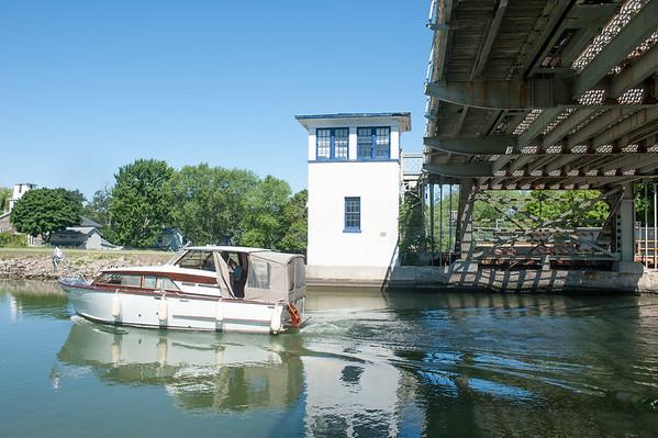 JOED VIERA/STAFF PHOTOGRAPHER-Lockport, NY- A boat passes underneath the Adams Street Bridge.