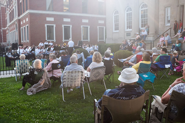 JOED VIERA/STAFF PHOTOGRAPHER-Lockport, NY-Visitors watch as the Lockport Community Band performs in front of the Lockport Public Library.