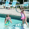 JOED VIERA/STAFF PHOTOGRAPHER Wilson, NY- Elena Bolos 6 and Emily Bolos 3 take a dip in Linnea's Pool.