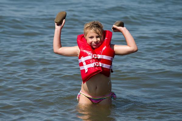 JOED VIERA/STAFF PHOTOGRAPHER Olcott, NY- Esabella Gatto 6 plays in Lake Ontario at Olcott Beach.