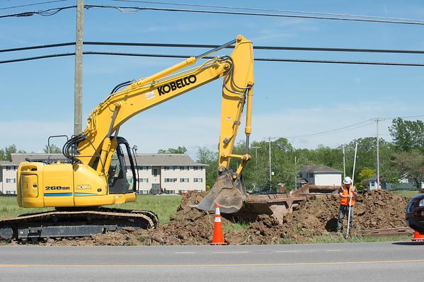 JOED VIERA/STAFF PHOTOGRAPHER-Pendleton, NY-Construction crews work on water lines on the corner of Tonawanda Creek Road and Transit Road.