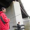 JOED VIERA/STAFF PHOTOGRAPHER-Lockport, NY-Ravi Prasad and his son Kiran fish on the Canal.