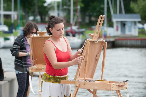 JOED VIERA/STAFF PHOTOGRAPHER-Lockport, NY-Buffalo State student Casey Kremblas paints at the Wilson Pier.