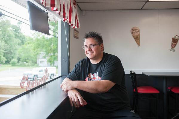JOED VIERA/STAFF PHOTOGRAPHER-Lockport, NY-David Reid sits in the newly opened Reid's ice cream shop.