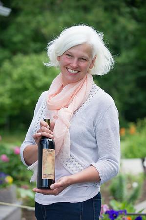 JOED VIERA/STAFF PHOTOGRAPHER-Lockport, NY-Robin Ross holds a new wine from Arrowhead Winery.