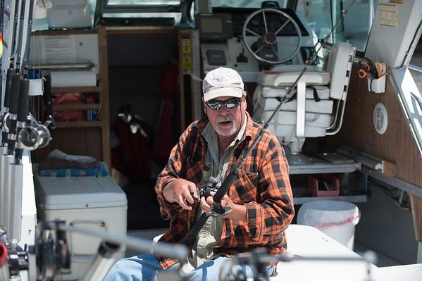 JOED VIERA/STAFF PHOTOGRAPHER-Olcott, NY-Lew Weaver prepares a rod for fishing at the Newfane Marina.