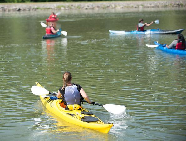 JOED VIERA/STAFF PHOTOGRAPHER-Lockport, NY-Ali Thompson leads Wyndam Lawn students on a kayak ride down the canal.