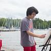 JOED VIERA/STAFF PHOTOGRAPHER-Lockport, NY-Buffalo State student Jun Ge paints at the Wilson Pier.