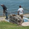 JOED VIERA/STAFF PHOTOGRAPHER-Olcott, NY-A crew works on the reconstruction of the wall along Olcott Beach.