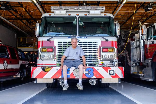 JOED VIERA/STAFF PHOTOGRAPHER-Middleport, NY-Middlepor firefighter Vern Fareweol sits on engine 3.