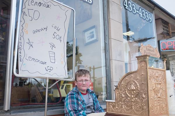 JOED VIERA/STAFF PHOTOGRAPHER-Lockport, NY-Andrew Honkonp 11 sells lemonade on Main Street.