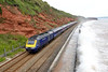 11 June 2015 :: With waves breaking against the sea wall between Dawlish and Dawlish Warren 43094 passes on 1A87, the 1413 from Paignton to Paddington