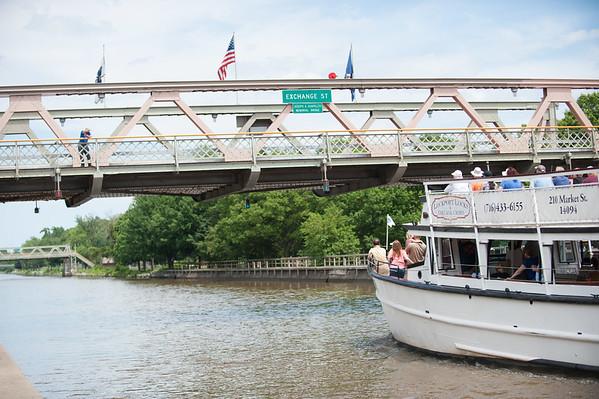 JOED VIERA/STAFF PHOTOGRAPHER-Lockport, NY-A canal tour rides under the Exchange Street Bridge.