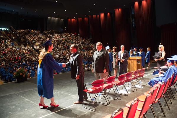 JOED VIERA/STAFF PHOTOGRAPHER-Lewiston, NY-Lockport High School student Robin Rush receives her diploma during her graduation ceremony at Artpark.