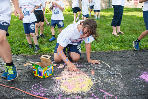 JOED VIERA/STAFF PHOTOGRAPHER-Lockport, NY-Gabby Rivera 11 draws with chalk during DeSales Field Day.