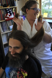 Kelly plays with Trevor's hair