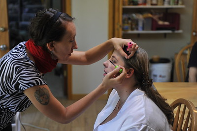 Tarena works on Kelly's makeup