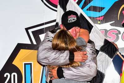 Chad Simpson hugs his wife, Katie, in victory lane