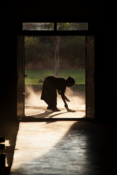 A sister cleans the floor of the church, a never-ending job in this environment of dust and dirt, and one that I have seen church members do quite a few times in the few days I have been here.