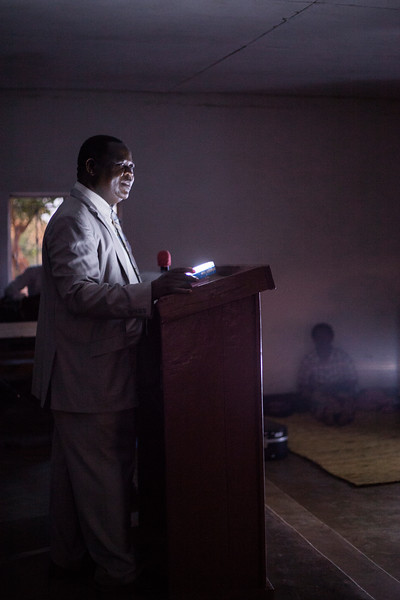 Church service with Bro. Charles' church, near downtown Lilongwe. The electricity at this church is unreliable, so flashlights are kept at-the-ready during service.