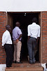 Men stand in the main doorway of the church, eager to hear during Saturday morning's service at the dedication meetings at Bro. Raphael's church in Lilongwe.