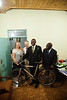 Bro. Ben unpackages his newest gift; a bicycle to replace his old broken one and bring him all over the local area doing missionary work.