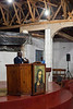 Pastor Stephen Kalua speaks to the church from the pulpit during a Wednesday night service.