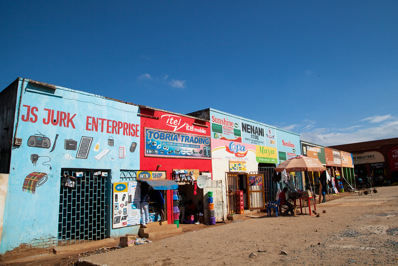 A section of store fronts in the Mzuzu market.