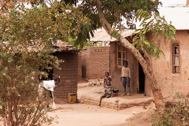 A family eyes the white guys as we walk past on our way to lunch in this small neighborhood.