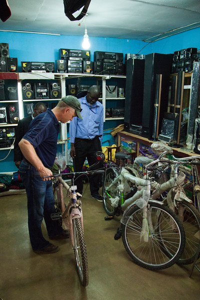 Bro. Joe checks out a bike to ensure it is of the best quality, prior to purchasing it to give to a local missionary.