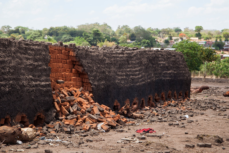 Local mud bricks are fired in giant piles that are both brick and kiln all in one. This pile suffered a collapse, displaying the structure of the interior.