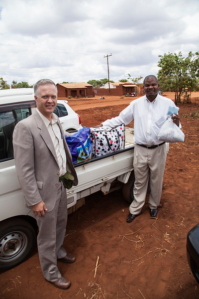 Bro. Joe gets the honors of presenting Bro. John with clothing donations which Bro. John will be taking to villagers in remote areas of Malawi.