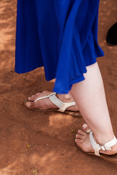 Naomi's feet are turning Malawian in the red dirt of this desert country.